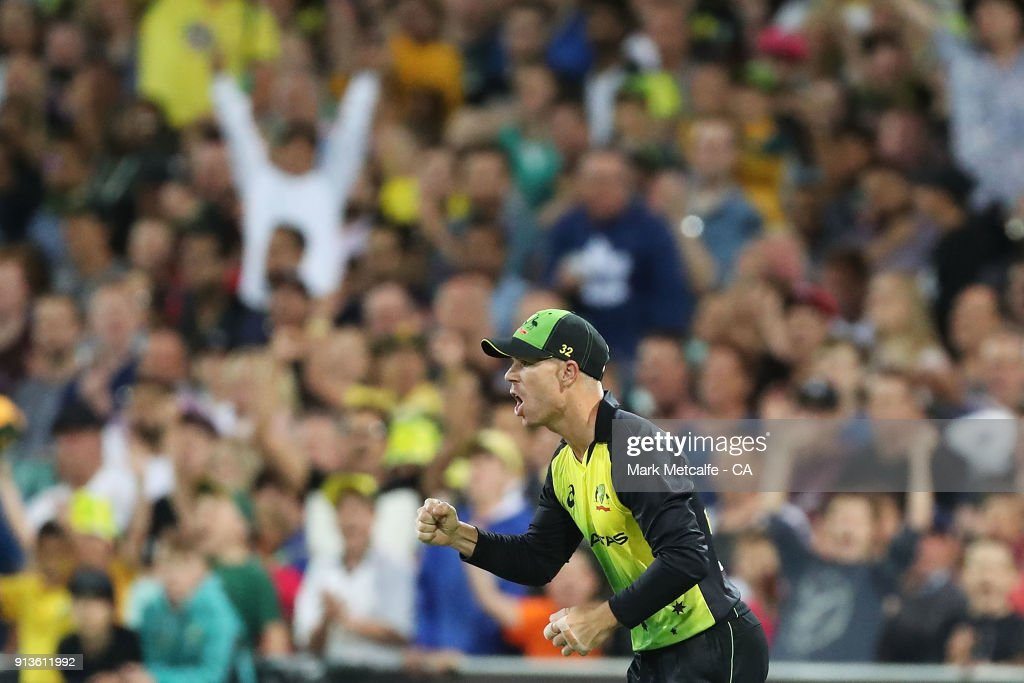 David Warner of Australia celebrates after taking a catch to dismiss Mitchell Santner of New Zealand during game one of the International Twenty20 series between Australia and New Zealand at Sydney Cricket Ground on February 3, 2018 in Sydney, Australia.