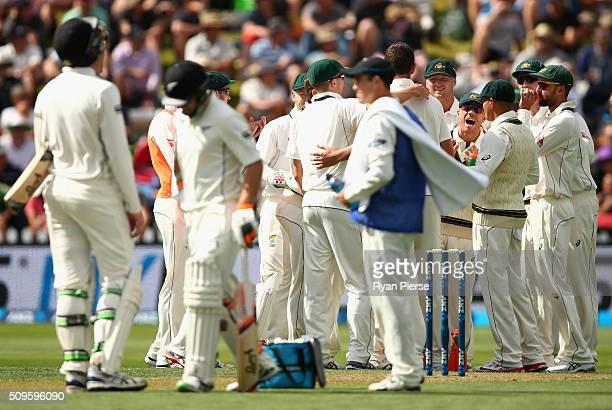 David Warner of Australia celebrates after Tom Latham of New Zealand was dismissed by Josh Hazlewood of Australia during day one of the Test match...