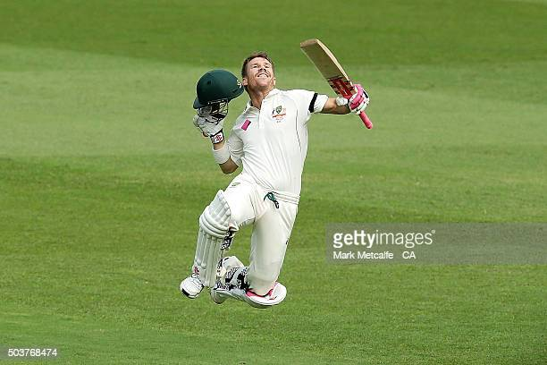 David Warner of Australia celebrates and acknowledges the crowd after scoring a century during day five of the third Test match between Australia and...