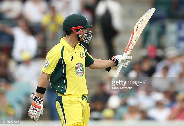 David Warner of Australia celebrates and acknowledges the crowd after scoring a half century during game two of the One Day International series...