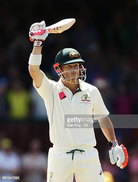 David Warner of Australia celebrates and acknowledges the crowd after scoring a half century during day four of the Third Test match between...