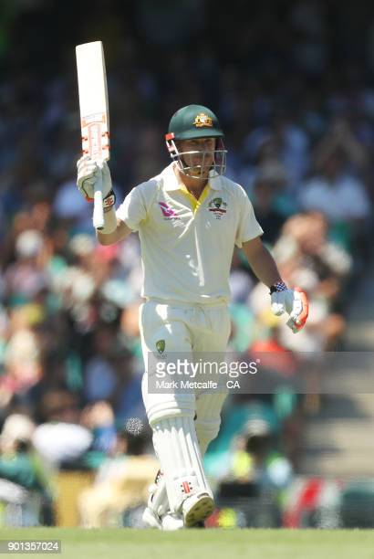 David Warner of Australia celebrates and acknowledges the crowd after scoring a half century during day two of the Fifth Test match in the 2017/18...