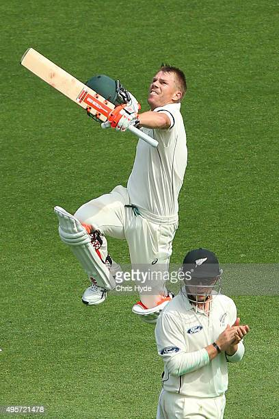 David Warner of Australia celebrates his century during day one of the First Test match between Australia and New Zealand at The Gabba on November 5...