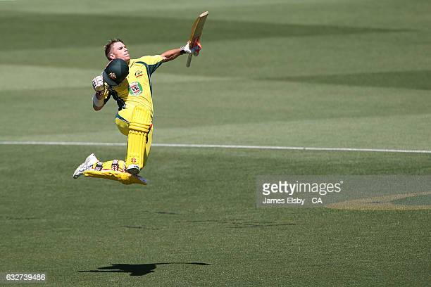 David Warner of Australia celebrates his century during game five of the One Day International series between Australia and Pakistan at Adelaide Oval...