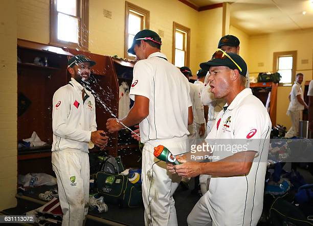 David Warner of Australia celebrates in the change rooms after day five of the Third Test match between Australia and Pakistan at Sydney Cricket...