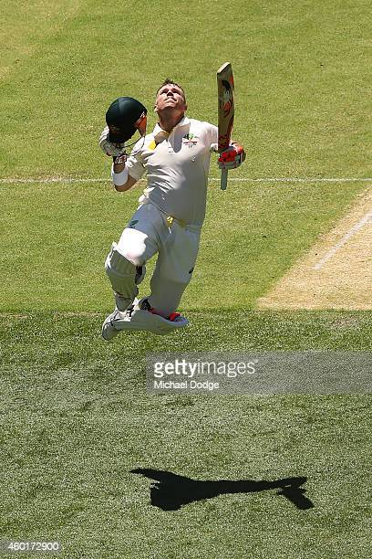 David Warner of Australia celebrates making his century during day one of the First Test match between Australia and India at Adelaide Oval on...