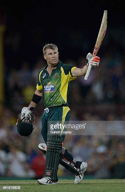 David Warner of Australia celebrates reaching his century during the One Day International series match between Australia and England at Sydney...