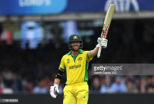David Warner of Australia celebrates reaching his half century during the Group Stage match of the ICC Cricket World Cup 2019 between England and...