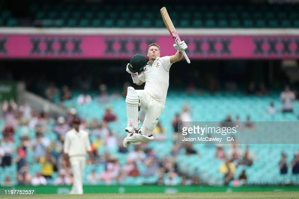 David Warner of Australia celebrates scoring a century during day four of the Third Test Match in the series between Australia and New Zealand at...