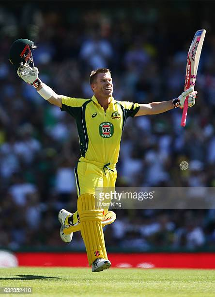 David Warner of Australia celebrates scoring a century during game four of the One Day International series between Australia and Pakistan at Sydney...