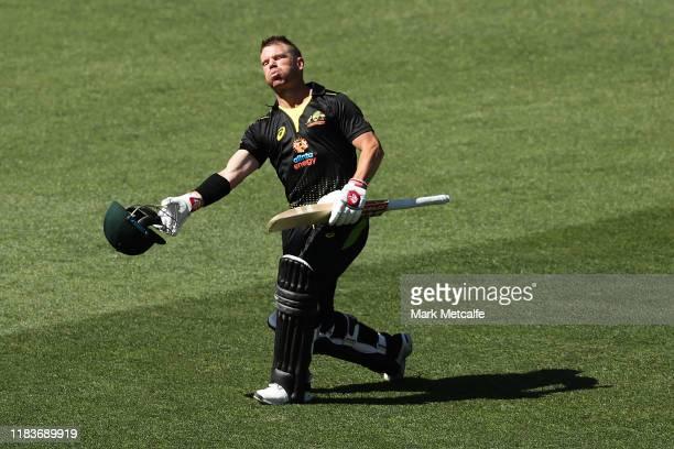 David Warner of Australia celebrates scoring a century during the Twenty20 International match between Australia and Sri Lanka at Adelaide Oval on...