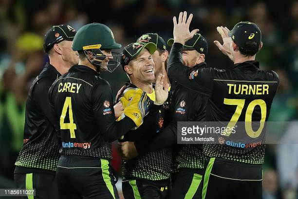 David Warner of Australia celebrates taking the wicket of Babar Azam of Pakistan by runout during game two of the International Twenty20 series...