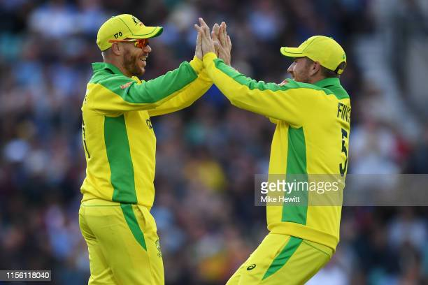 David Warner of Australia celebrates with Aaron Finch after catching Thisara Perera of Sri Lanka during the Group Stage match of the ICC Cricket...