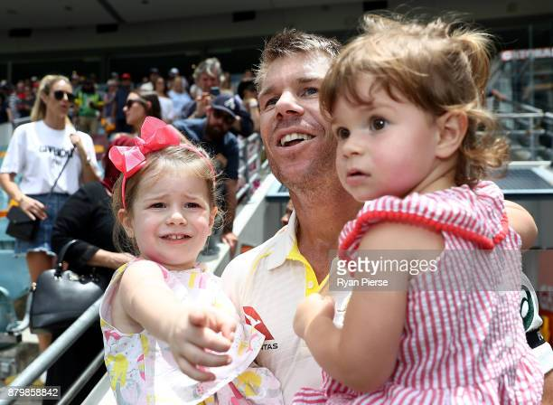 David Warner of Australia celebrates with his daughters Ivy and Indi after Australia hit the winning runs during day five of the First Test Match of...