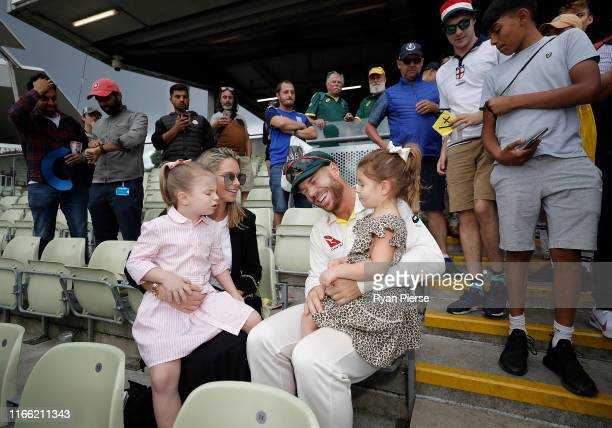 David Warner of Australia celebrates with his wife Candice Warner and daughters Indi and Ivy after day five of the 1st Specsavers Ashes Test between...