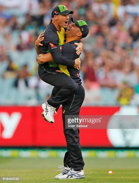 David Warner of Australia celebrates with Marcus Stoinis after running out Dawid Malan of England during game two of the International Twenty20...
