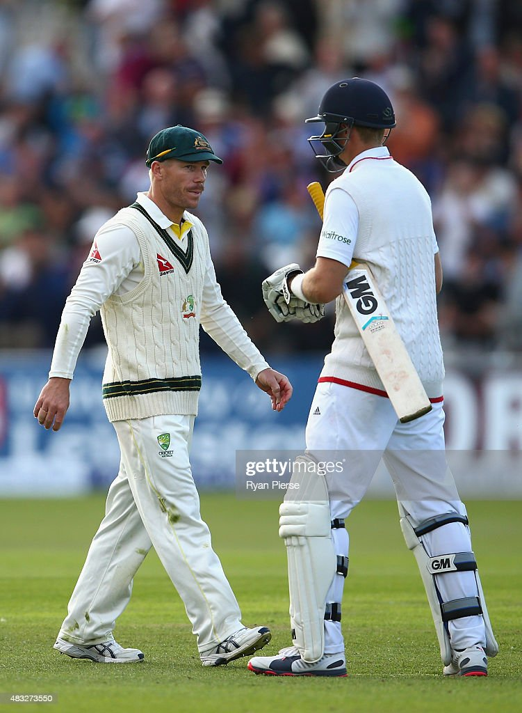 David Warner of Australia congratulates Joe Root of England at stumps during day one of the 4th Investec Ashes Test match between England and Australia at Trent Bridge on August 6, 2015 in Nottingham, United Kingdom.