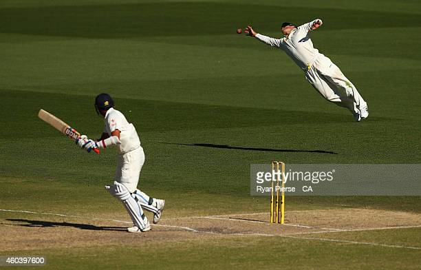 David Warner of Australia dives for the ball during day five of the First Test match between Australia and India at Adelaide Oval on December 13 2014...