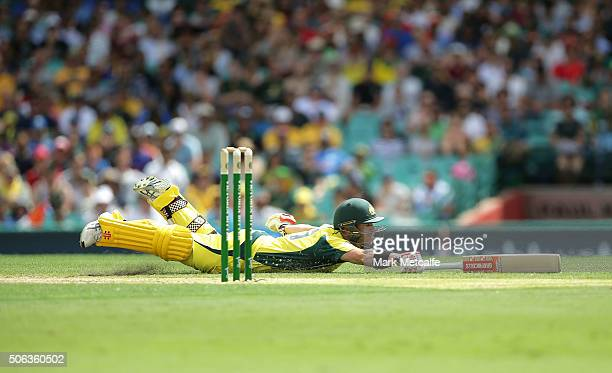 David Warner of Australia dives to make his crease during game five of the Commonwealth Bank One Day Series match between Australia and India at...