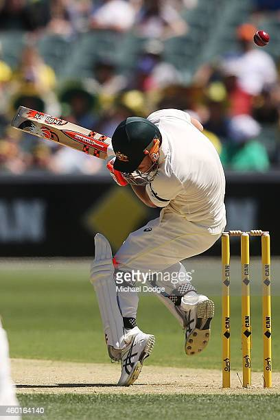 David Warner of Australia ducks the first bouncer of the innings bowled by Varun Aaron of India during day one of the First Test match between...