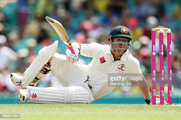 David Warner of Australia ducks under a bouncer from Mohammad Amir of Pakistan during day one of the Third Test match between Australia and Pakistan...