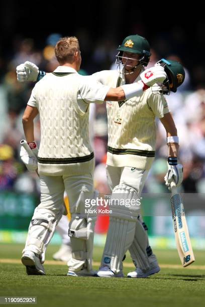 David Warner of Australia embraces Steve Smith of Australia as Warner celebrates his double century during day two of the 2nd Domain Test between...