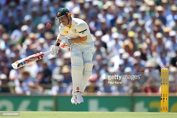 David Warner of Australia fends off an uppish delivery from Stuart Broad of England during day one of the Third Ashes Test Match between Australia...