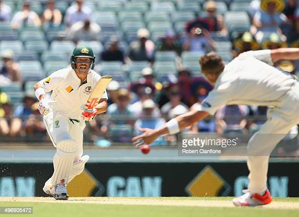 David Warner of Australia gets his shot past Tim Southee of New Zealand during day one of the second Test match between Australia and New Zealand at...