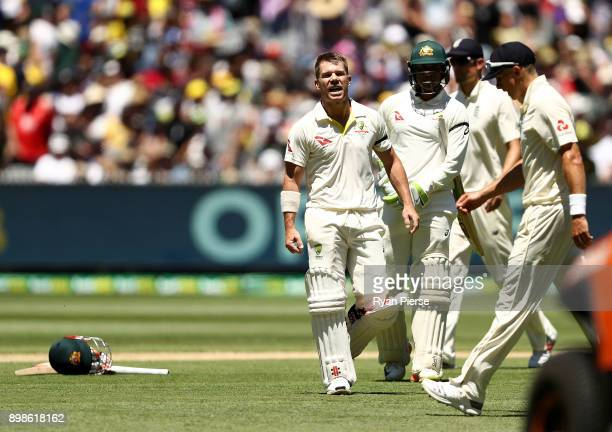 David Warner of Australia has words with Tom Curran of England after he scored his century during day one of the Fourth Test Match in the 2017/18...