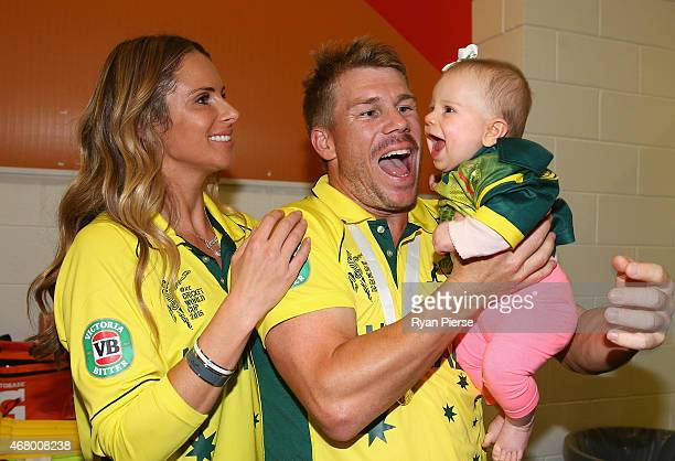 David Warner of Australia his fiance Candice Falzon and their daughter Ivy Warner pose in the changerooms during the 2015 ICC Cricket World Cup final...
