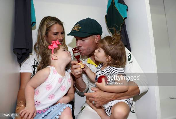 David Warner of Australia his wife Candice Warner and their daughters Ivy and Indi celebrate in the changerooms after Australia regained the Ashes...