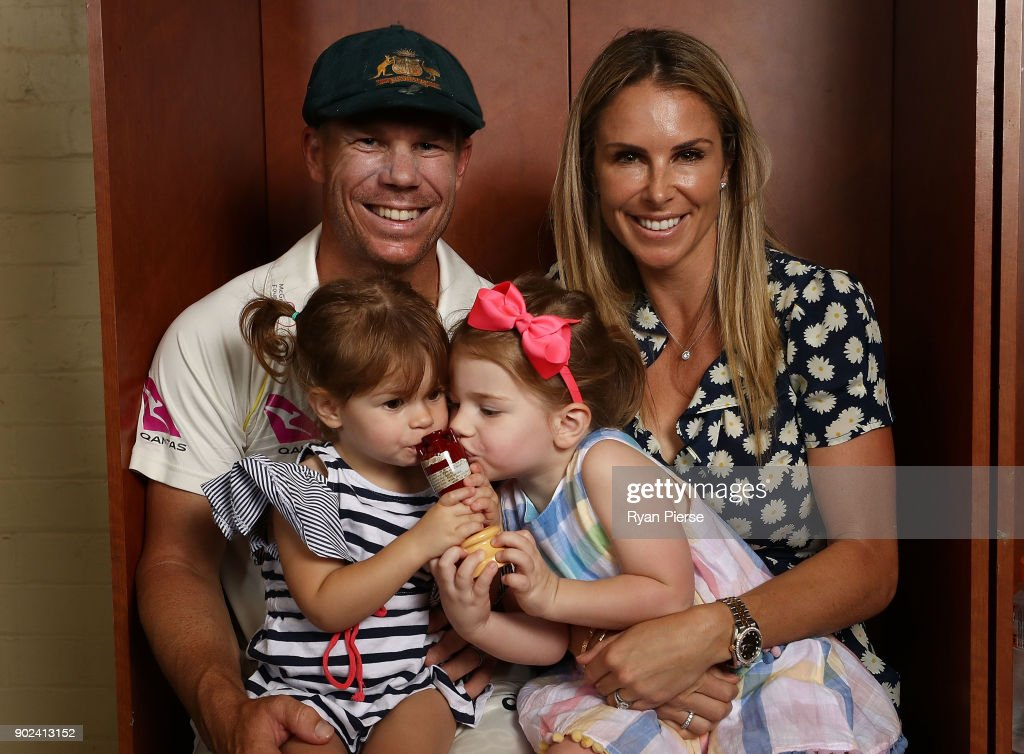 David Warner of Australia, his wife Candice Warner and their daughters Indi and Ivy, celebrate with the Ashes Urn in the change rooms during day five of the Fifth Test match in the 2017/18 Ashes Series between Australia and England at Sydney Cricket Ground on January 8, 2018 in Sydney, Australia.