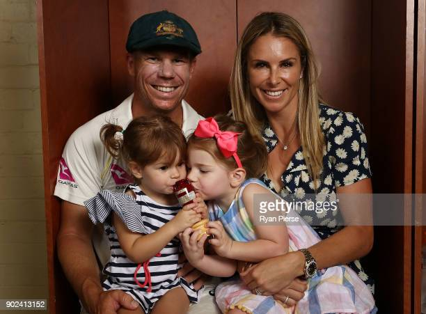 David Warner of Australia his wife Candice Warner and their daughters Indi and Ivy celebrate with the Ashes Urn in the change rooms during day five...