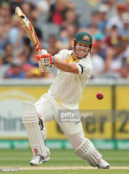 David Warner of Australia hits a boundary during day four of the Third Test match between Australia and India at Melbourne Cricket Ground on December...