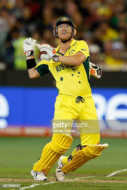 David Warner of Australia hits a high ball during the 2015 ICC Cricket World Cup final match between Australia and New Zealand at Melbourne Cricket...