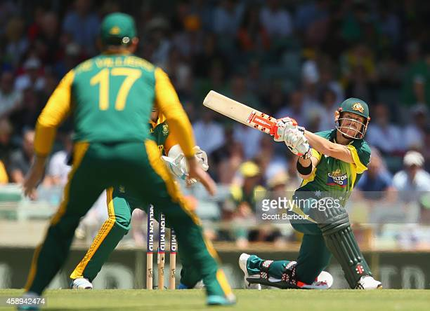 David Warner of Australia hits a six during game one of the men's one day international series between Australia and South Africa at WACA on November...