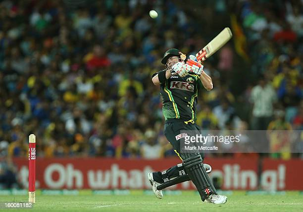 David Warner of Australia hits a six during game one of the Twenty20 international match between Australia and Sri Lanka at ANZ Stadium on January 26...