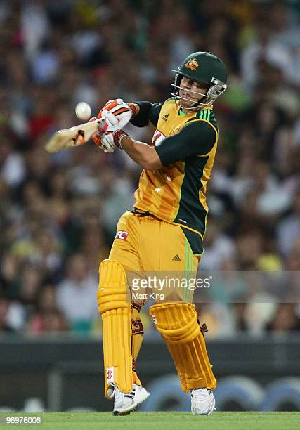 David Warner of Australia hits a six during the Twenty20 International match between Australia and the West Indies at the Sydney Cricket Ground on...