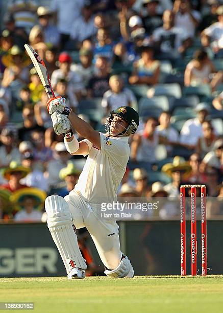 David Warner of Australia hits a six to bring up his century during day one of the third Test match between Australia and India at WACA on January 13...