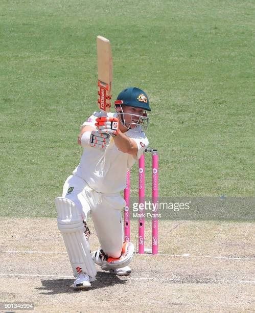 David Warner of Australia hits four runs off the bowling of Tom Curran of England during day two of the Fifth Test match in the 2017/18 Ashes Series...