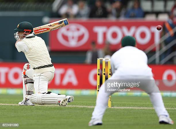 David Warner of Australia hits out during day one of the Second Test match between Australia and South Africa at Blundstone Arena on November 12 2016...