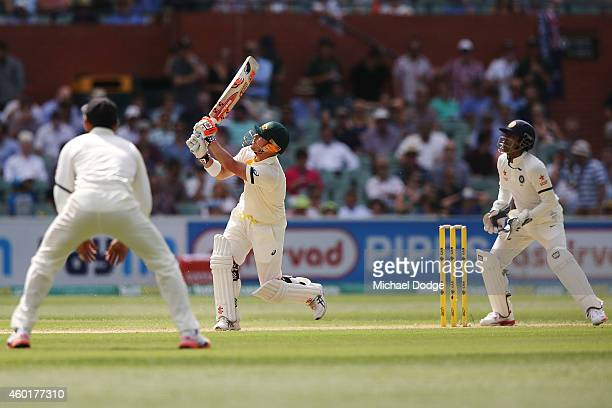 David Warner of Australia hits the ball and is caught by Ishant Sharma of India off the bowling of Karn Sharma during day one of the First Test match...