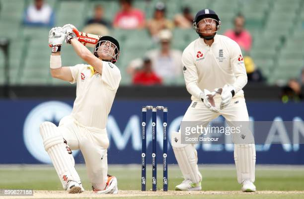 David Warner of Australia hits the ball in the air and is out caught from the bowling of Joe Root of England during day one of the Fourth Test Match...