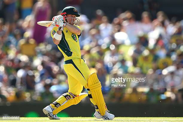 David Warner of Australia hits the ball to the boundary during game three of the One Day International series between Australia and Pakistan at WACA...
