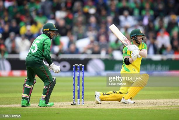 David Warner of Australia in action batting as Mushfiqur Rahim of Bangladesh looks on during the Group Stage match of the ICC Cricket World Cup 2019...