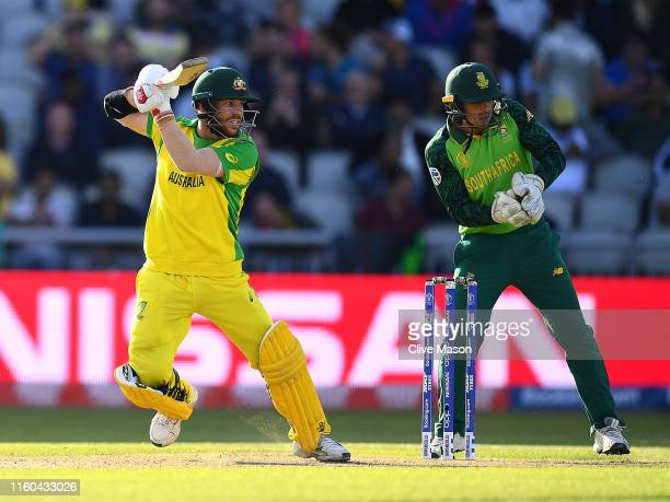 David Warner of Australia in action batting as Quinton de Kock of South Africa looks on during the Group Stage match of the ICC Cricket World Cup...