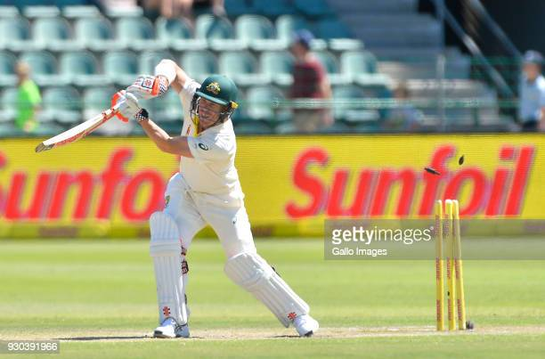 David Warner of Australia is bowled by Kagiso Rabada of South Africa during day 3 of the 2nd Sunfoil Test match between South Africa and Australia at...