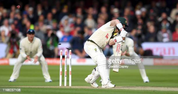 David Warner of Australia is bowled by Stuart Broad of England during day two of the 2nd Specsavers Ashes Test match at Lord's Cricket Ground on...
