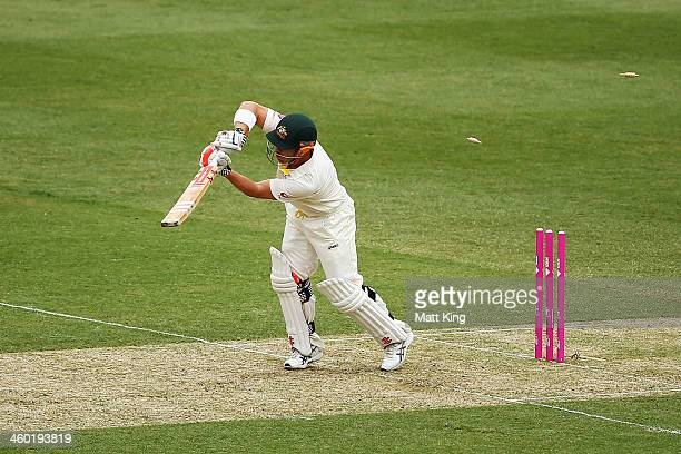 David Warner of Australia is bowled by Stuart Broad of England during day one of the Fifth Ashes Test match between Australia and England at Sydney...