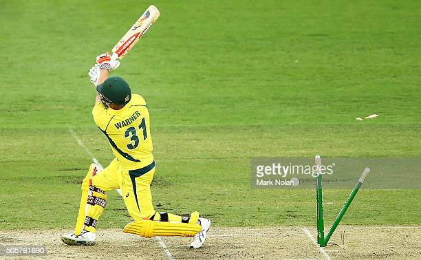 David Warner of Australia is bowled during the Victoria Bitter One Day International match between Australia and India at Manuka Oval on January 20...